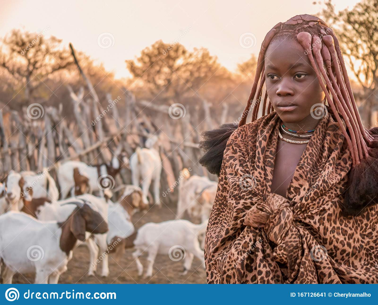traditional Village of Purros, Himba woman with children