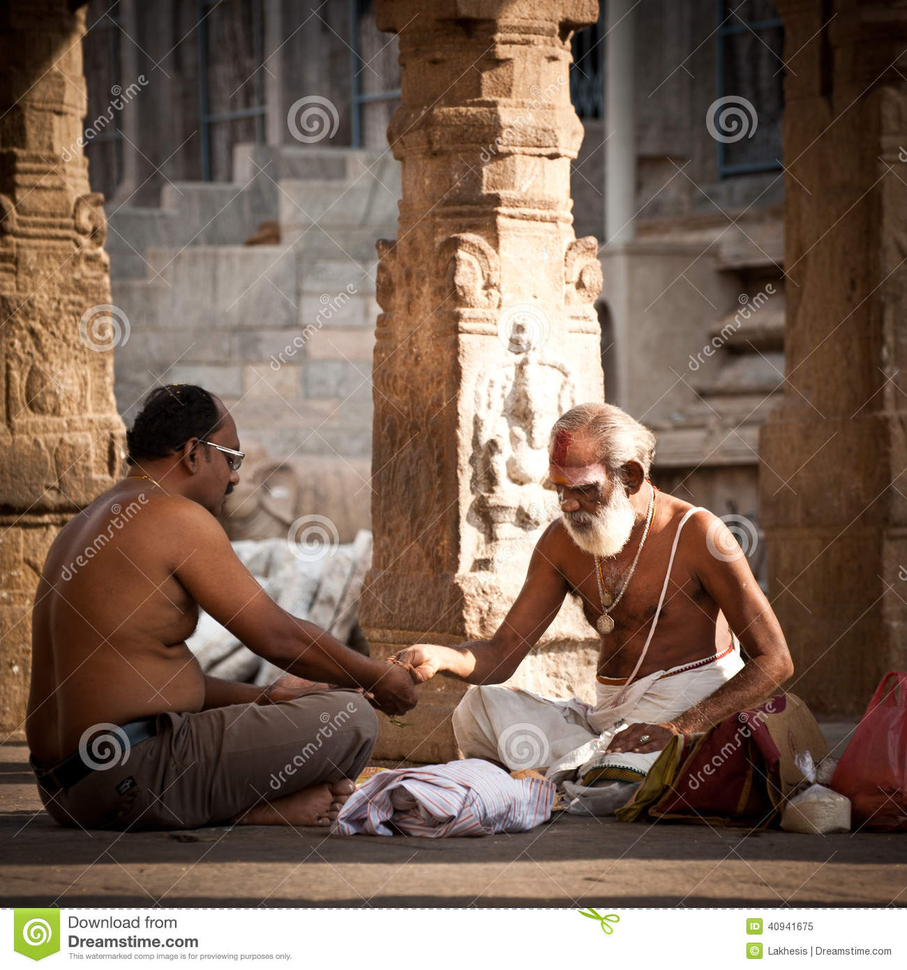 Hindu Brahmin With Religious Attributes Blessing People At