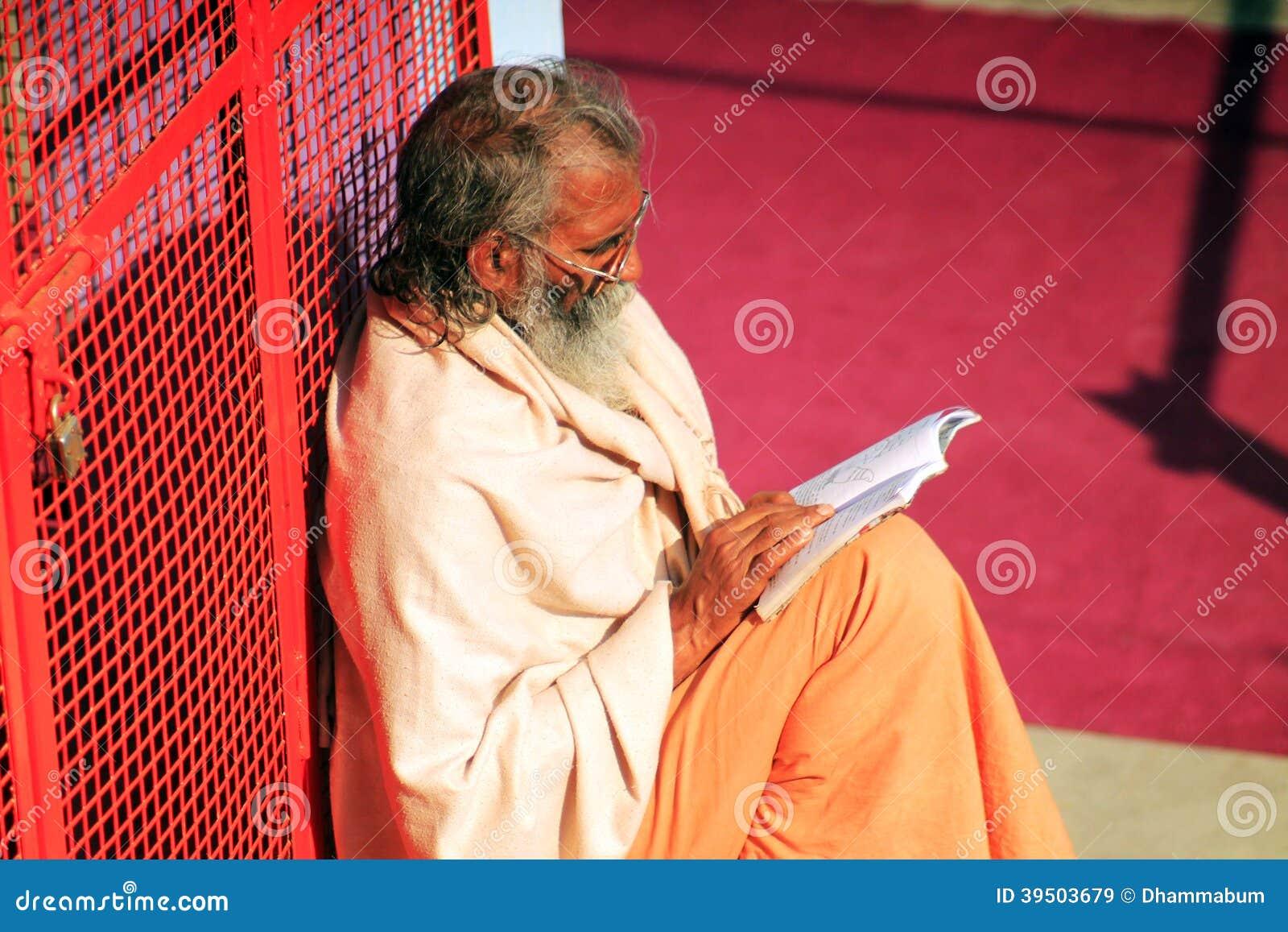 Hindu bramin reading a book