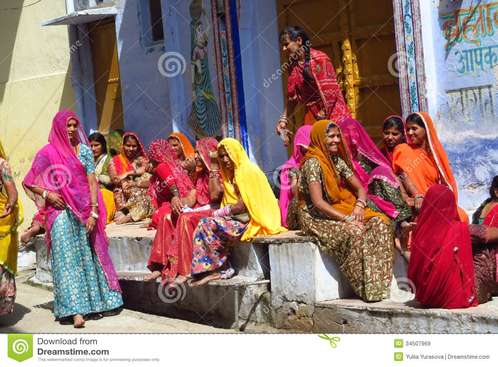 Hindu women dressed in colorful sari in Indian street market