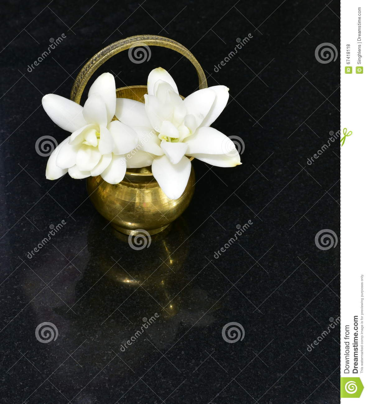 Hinduism prayer brass water pot or kamandal with jasmine flowers hinduism prayer brass water pot or kamandal with jasmine flowers izmirmasajfo
