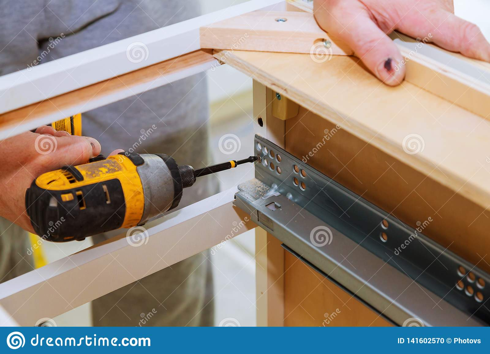 Hinge Drawers Assembly On Kitchen Cabinet Door Stock Photo ...