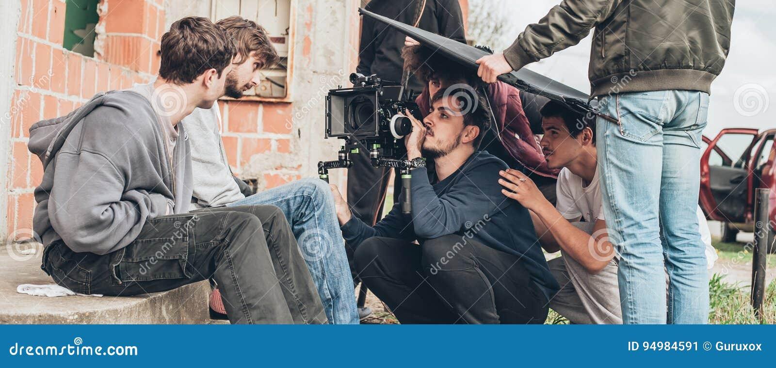 Hinter der Szene Filmteamschmierfilmbildungs-Filmszene im Freien