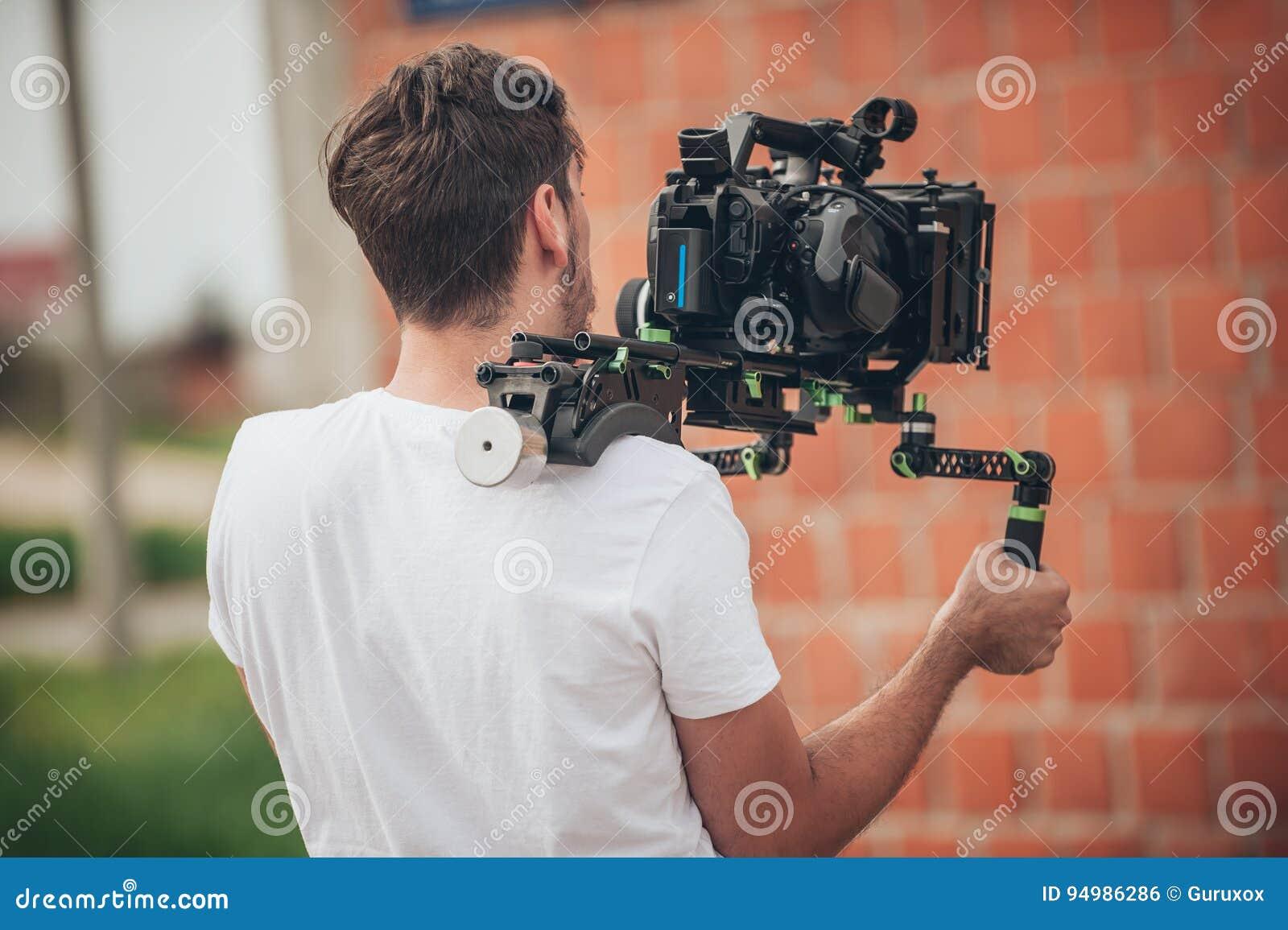 Hinter der Szene Kameramannschießen-Filmszene mit seiner Kamera