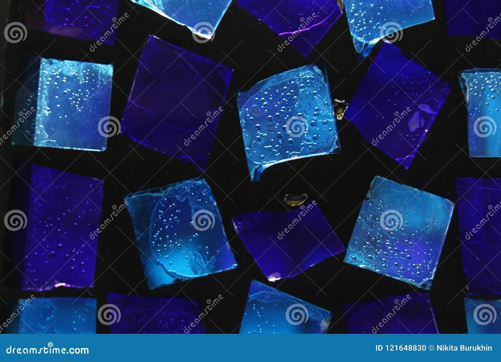 Hintergrund des blauen kleinen Glases