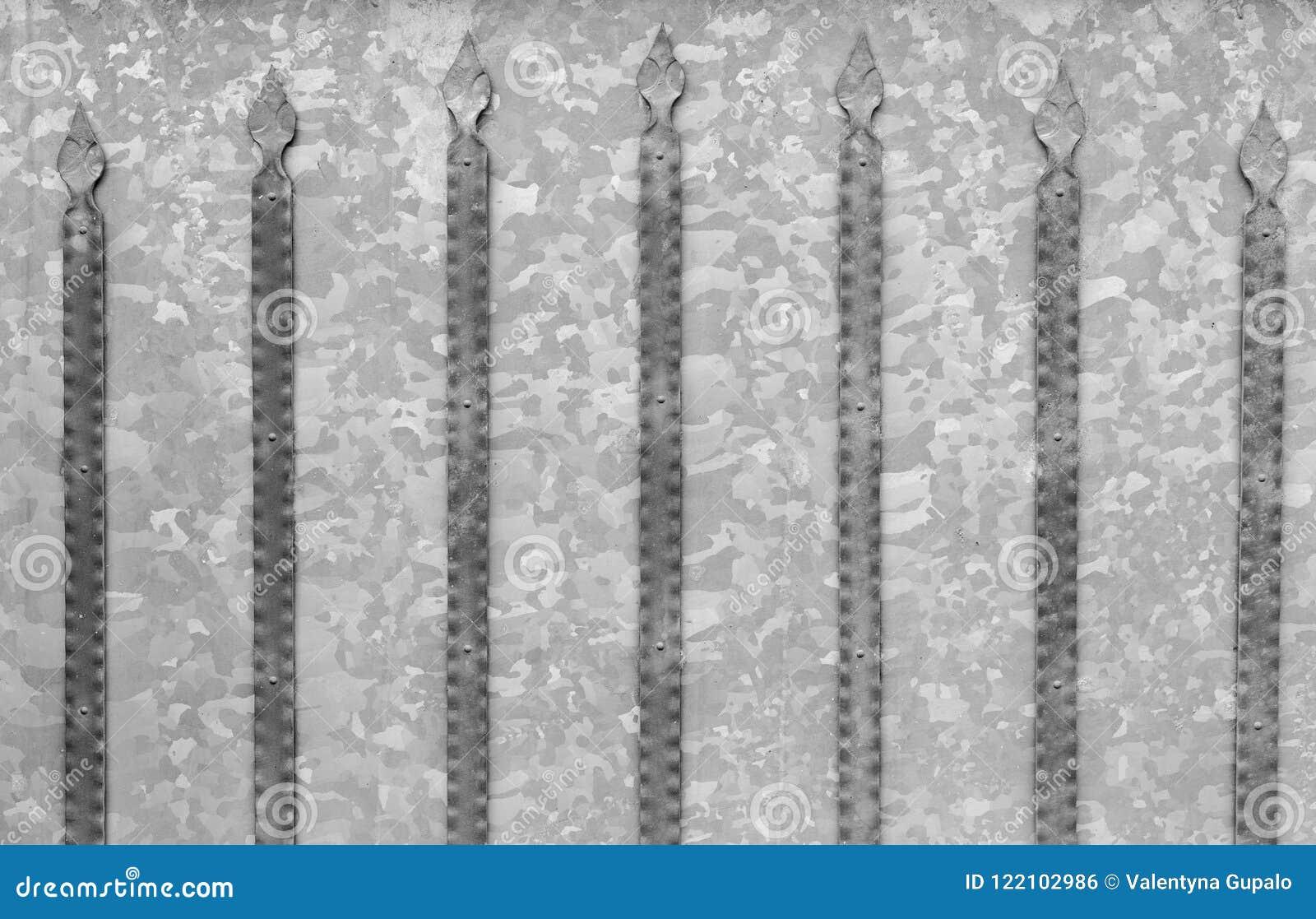 Hintergrundbeschaffenheit von galvanisierten Stahltoren mit Metalldetails