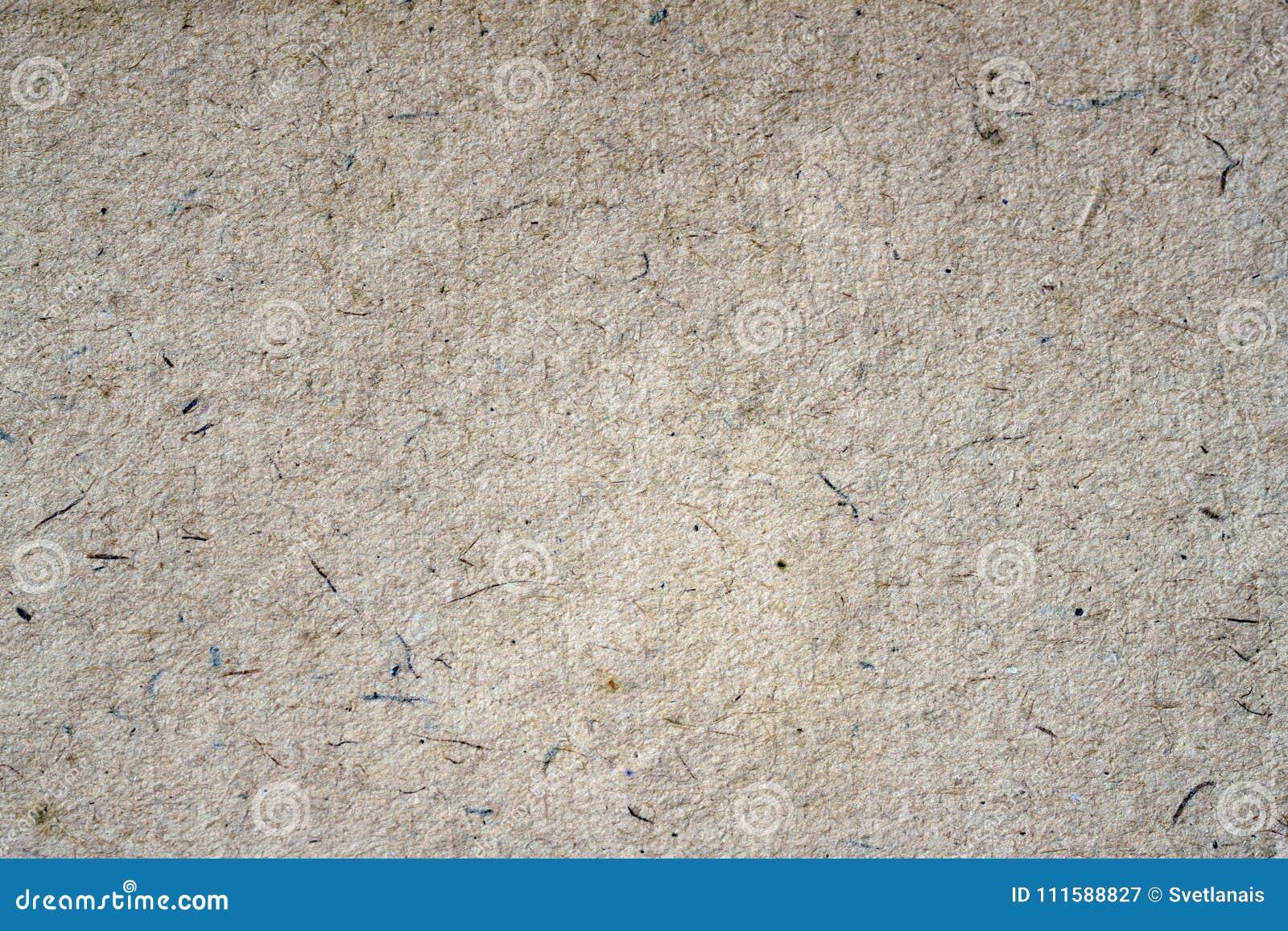 Hintergrundnahaufnahme der Papierbeschaffenheit organische Papp Schmutzalte Papieroberfläche mit Zellulose, Fragmente, Stoppel, H