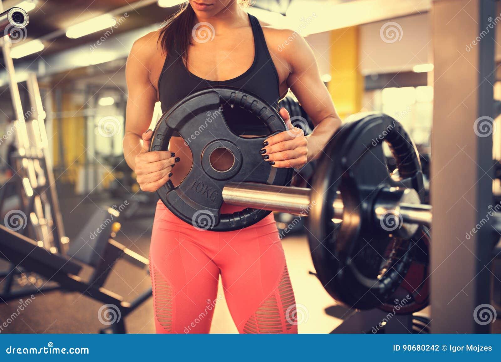 Hinzufügen von Gewichten auf Barbell, Konzept