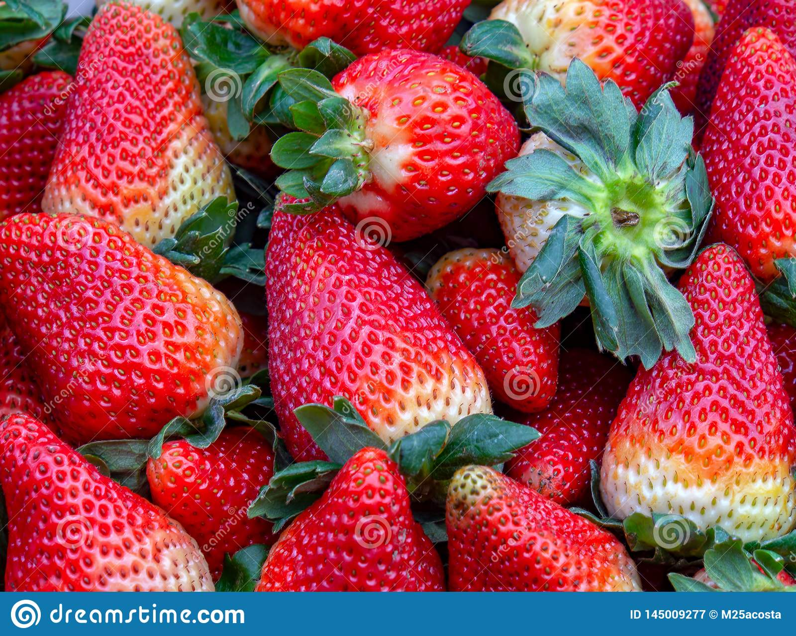 Hipe of strawberries in a market