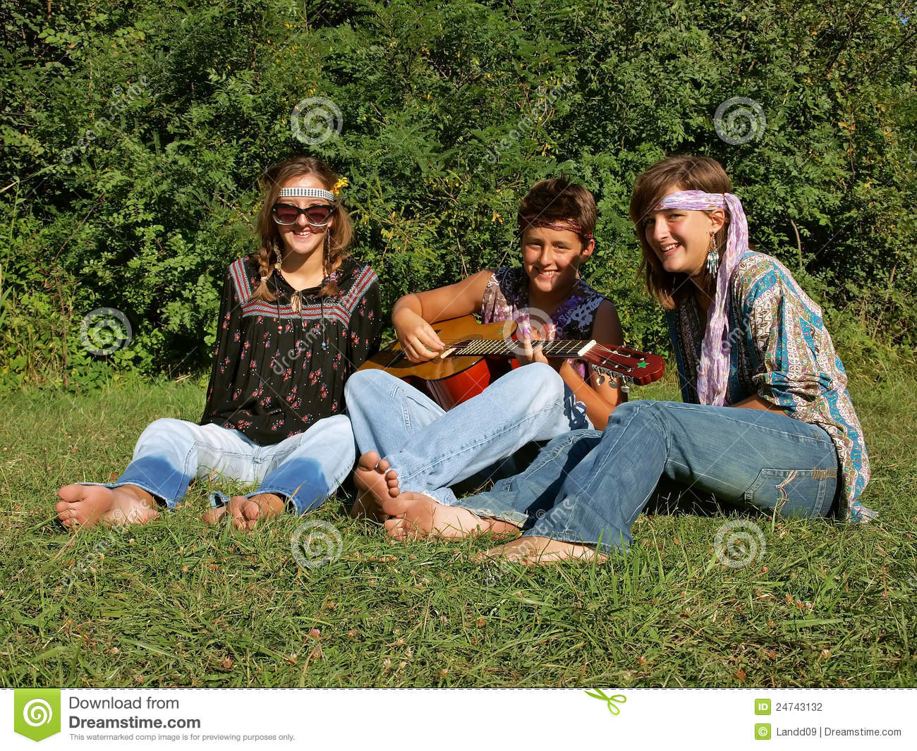 Teenager (best friends) with guitar (dressed in hippie clothes with a ...