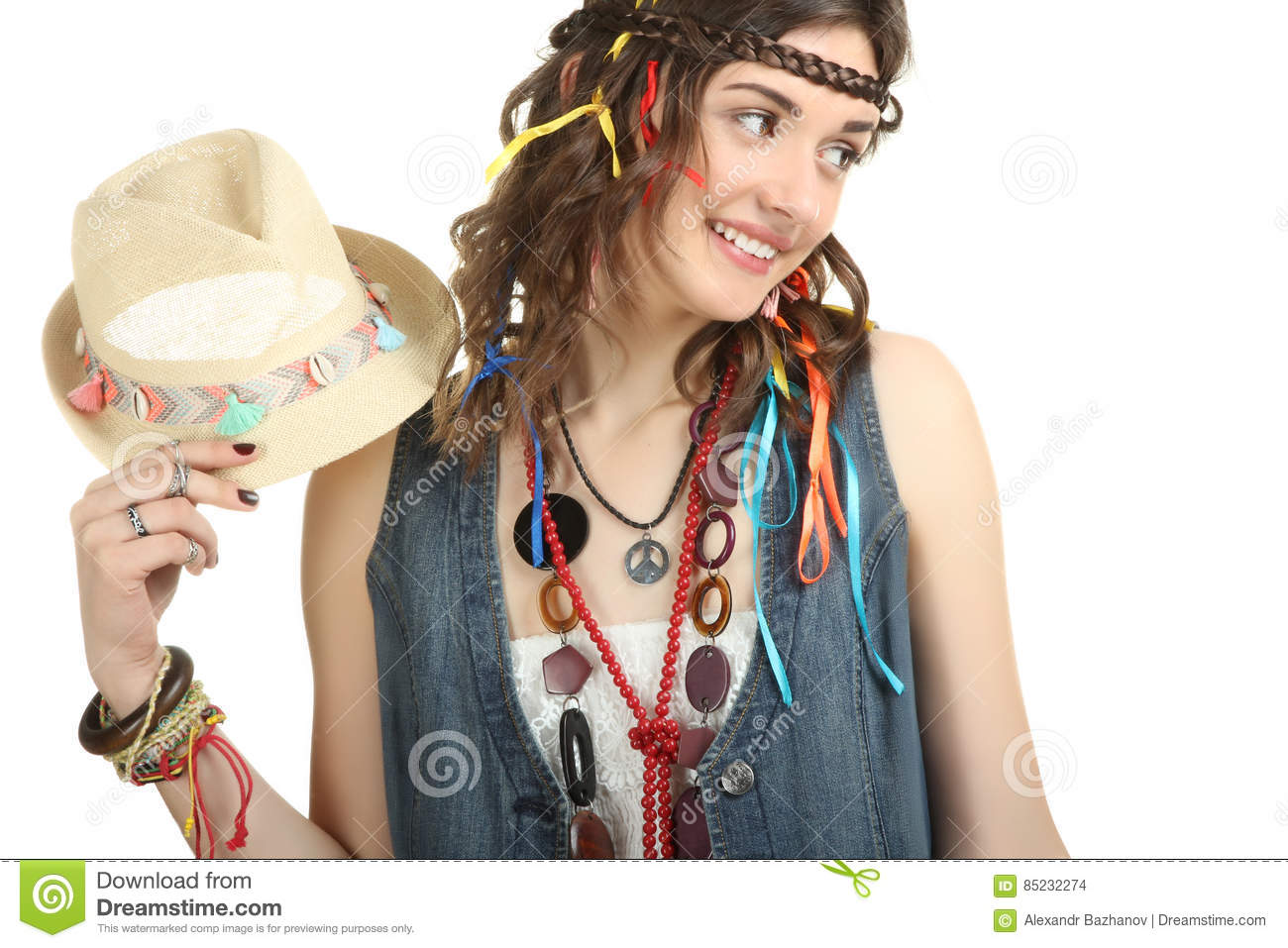 Happy hippie girl holding a stylish hat isolated on a white background. bb58dbb12a1