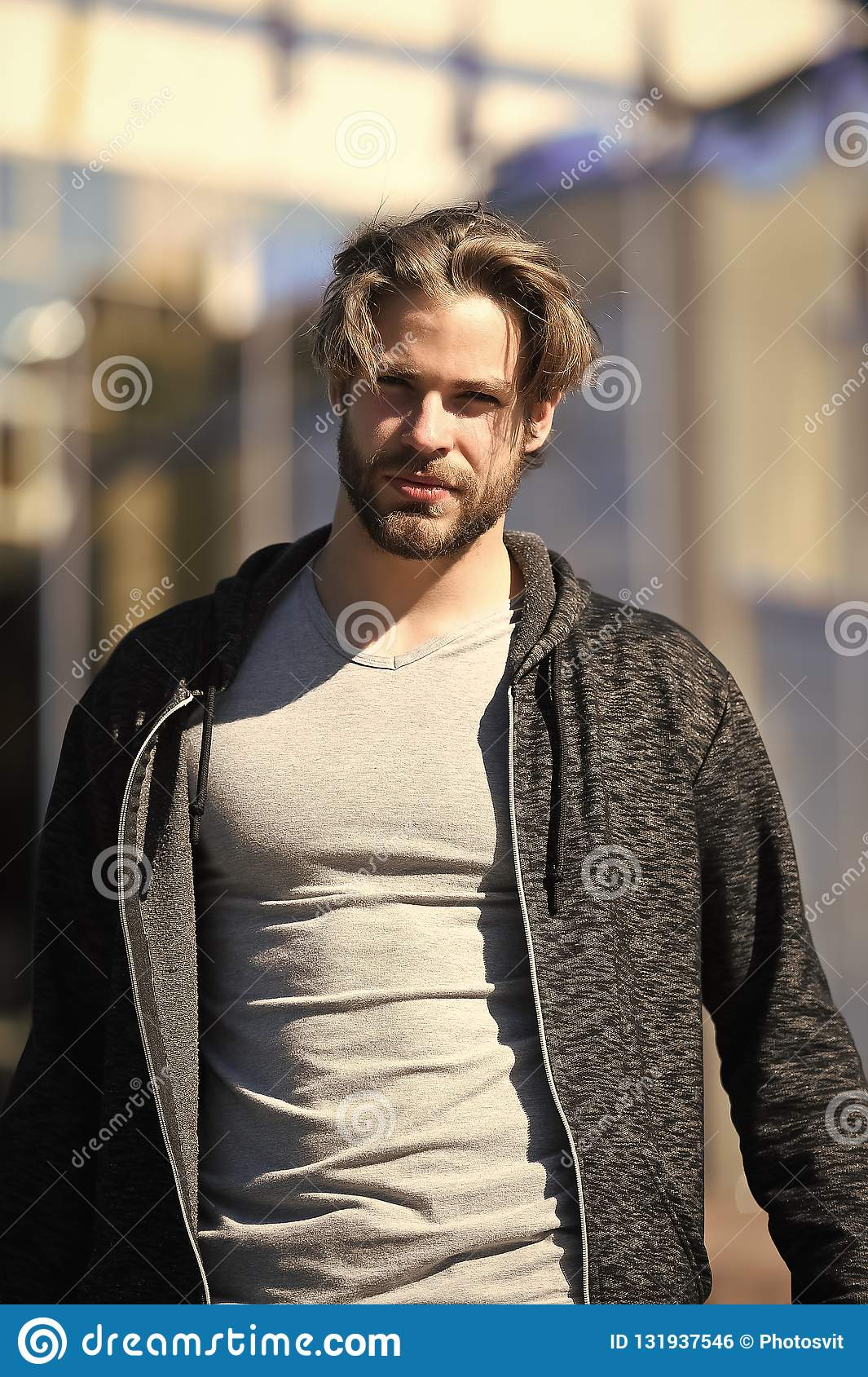 Hipster With Beard And Haircut Walking On Street Stock Photo