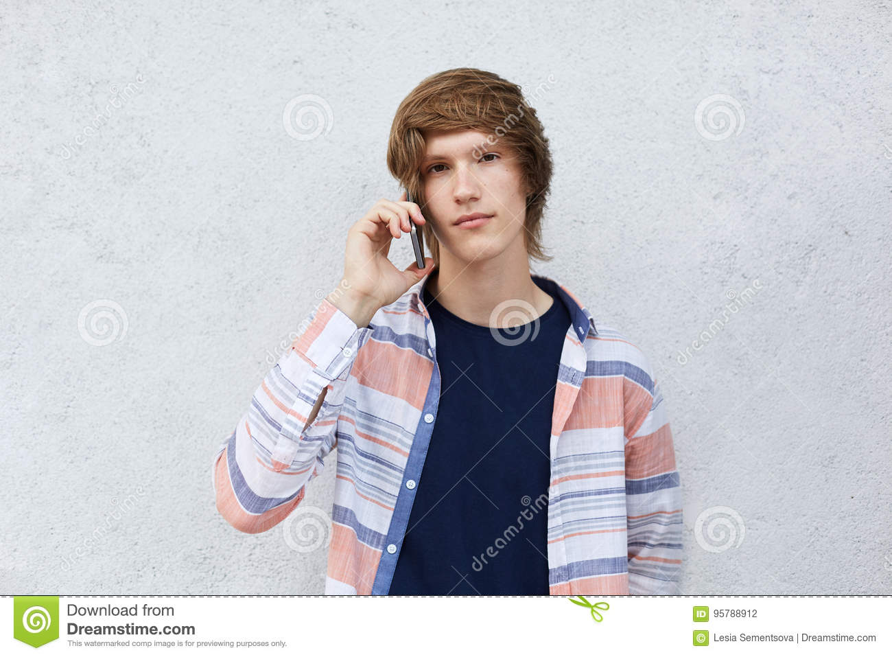 Hipster Boy With Dark Eyes And Stylish Hairstyle Having Serious