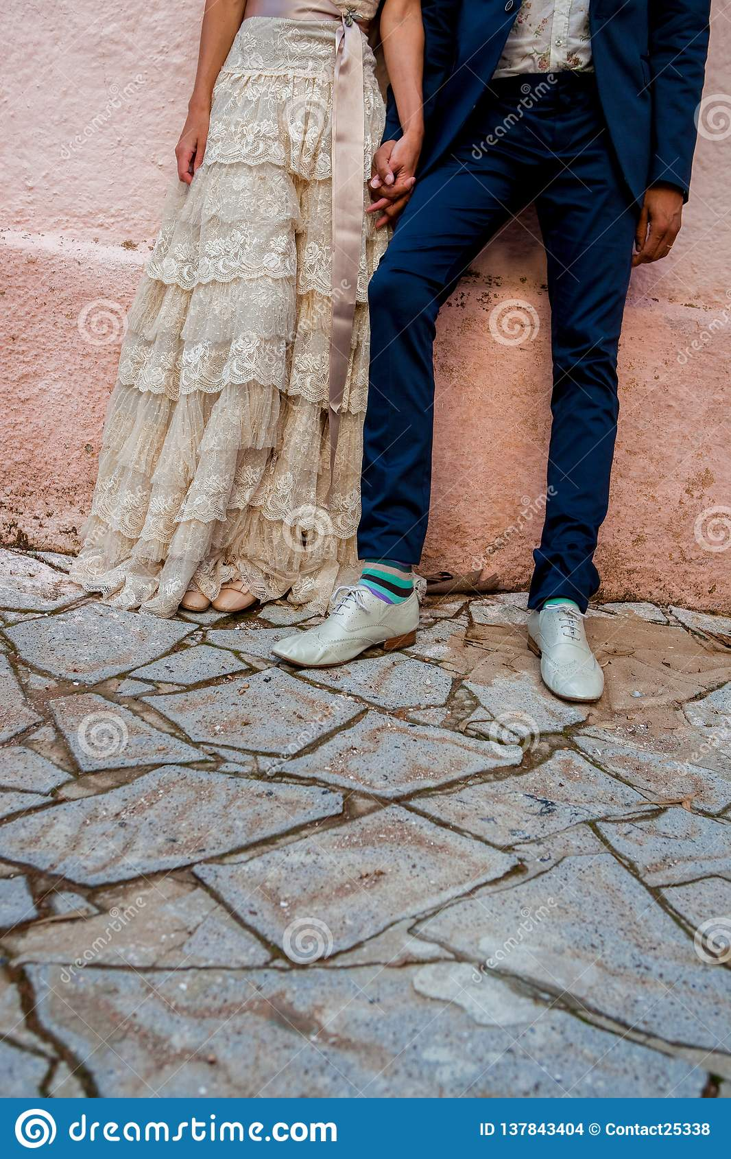 A Hipster Couple Bride And Groom With Coloured Funky Socks And A