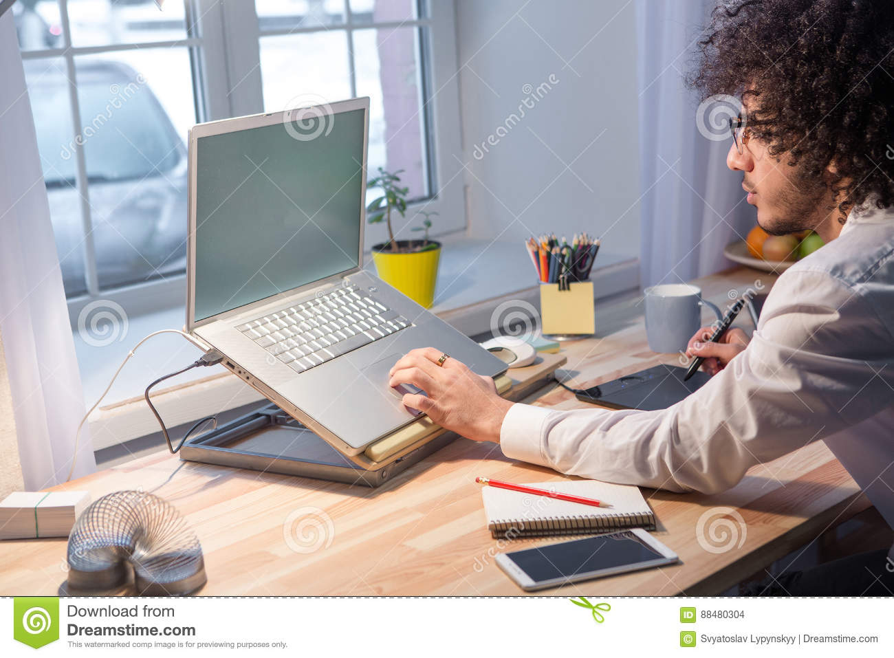 Hipster freelance man working at home