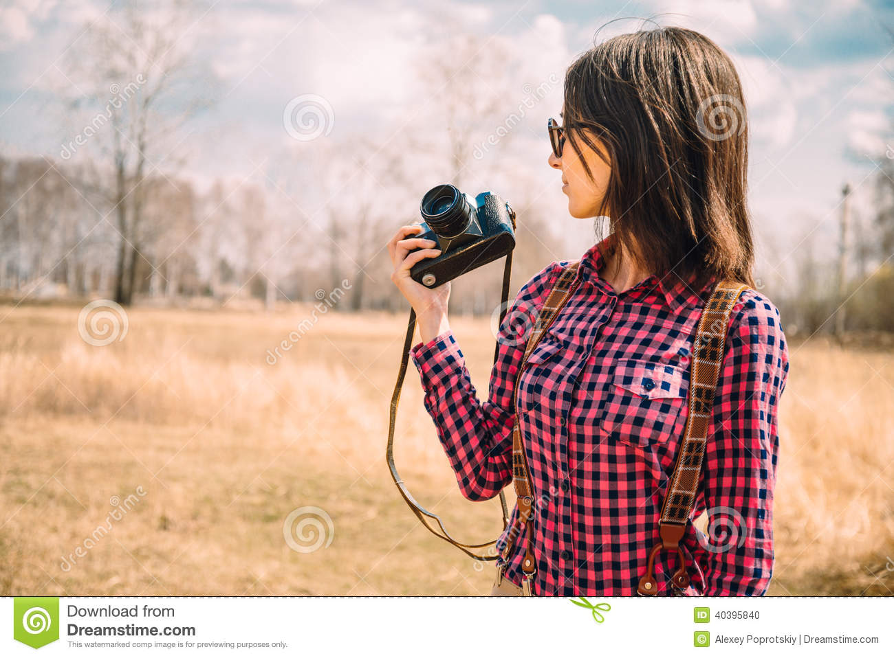 Hipster girl with photo camera on nature