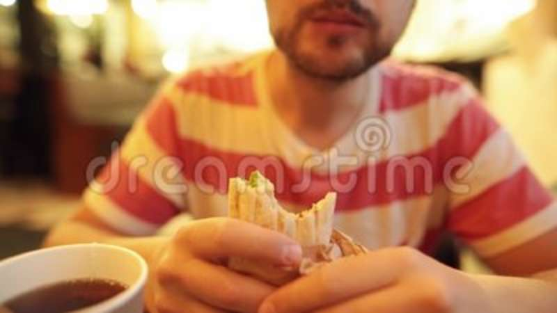 Hipster Guy Is Eating A Delicious Juicy Chicken Doner With A Tea