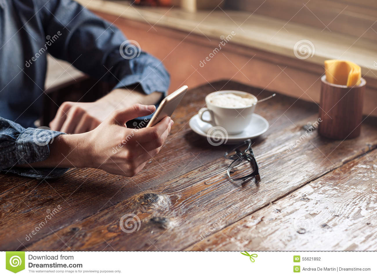 Hipster guy texting with his mobile phone