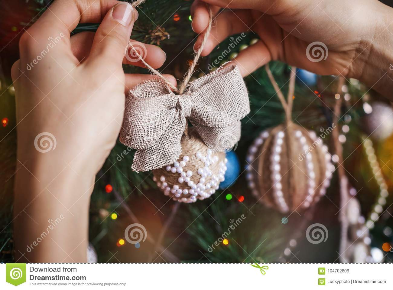 hipster hands with christmas sackcloth ball and bow stock photo