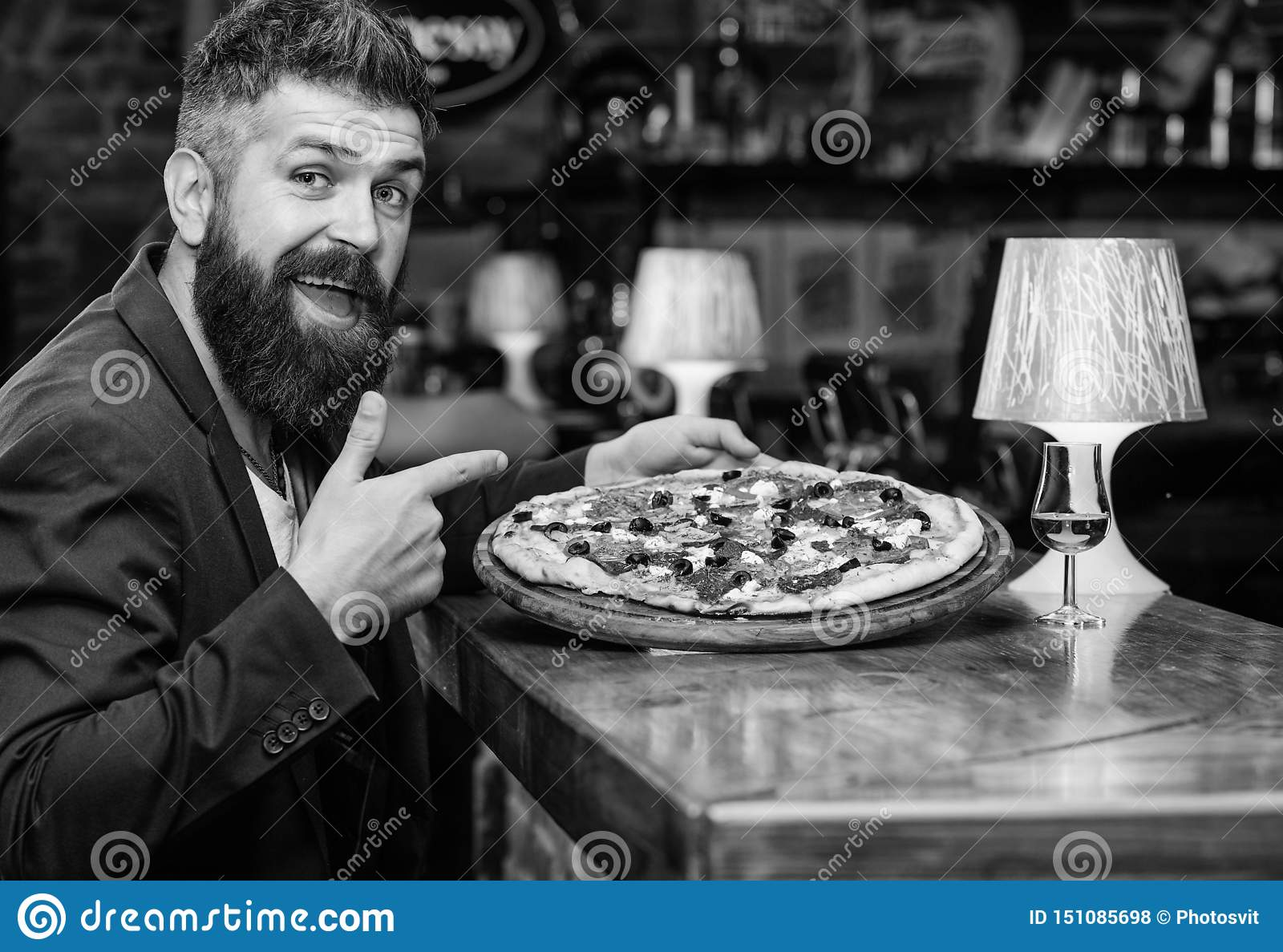 Hipster hungry eat italian pizza. Pizza favorite restaurant food. Fresh hot pizza for dinner. Hipster client sit at bar