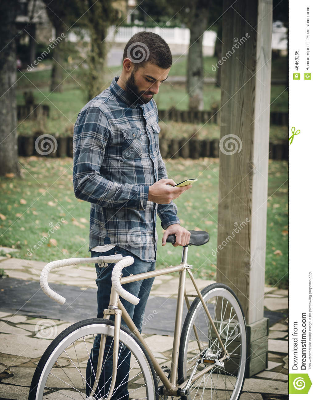 Hipster Man With A Fixie Bike And Smartphone Stock Image Image