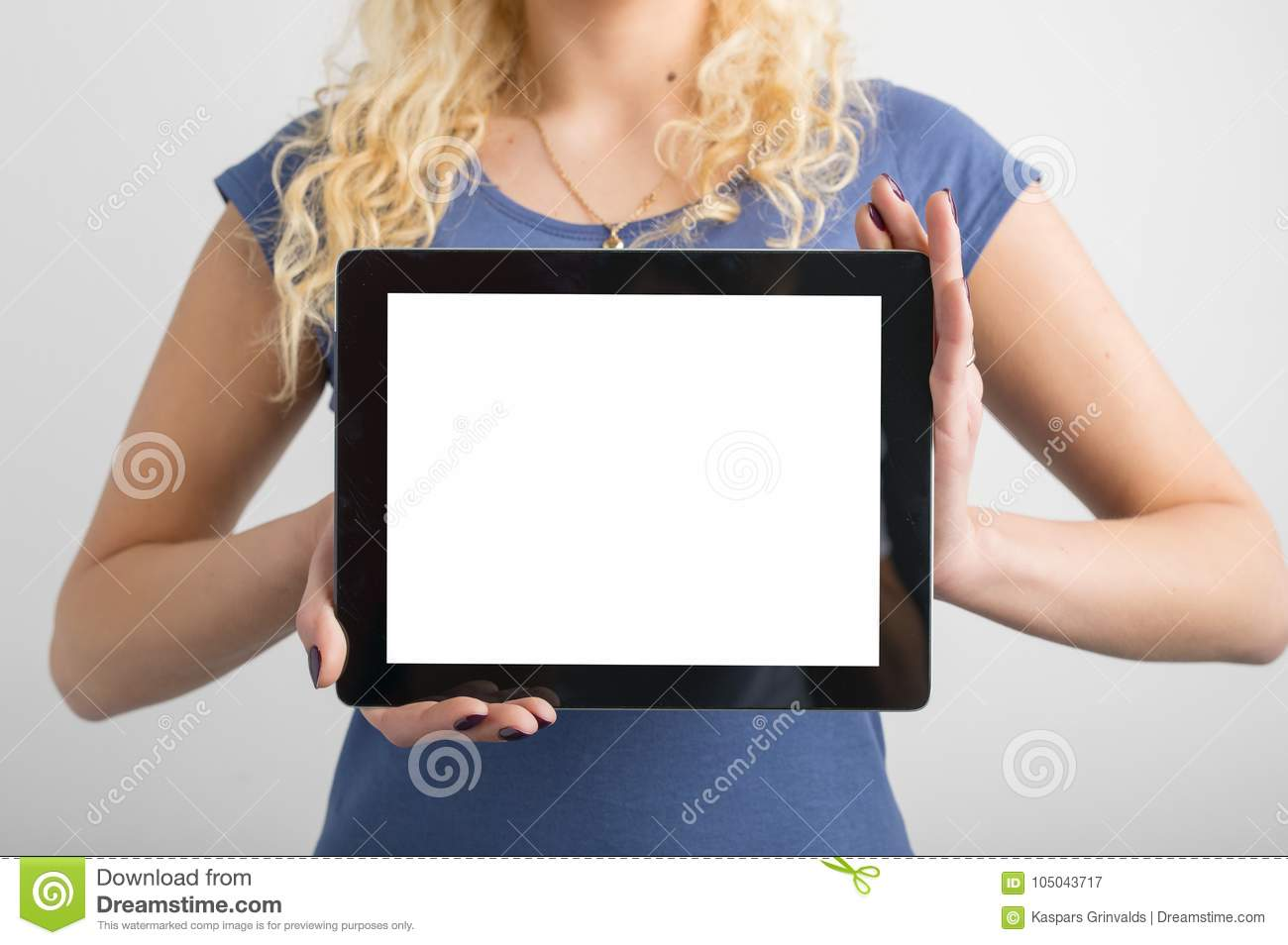 Person holding blank screen tablet in hands