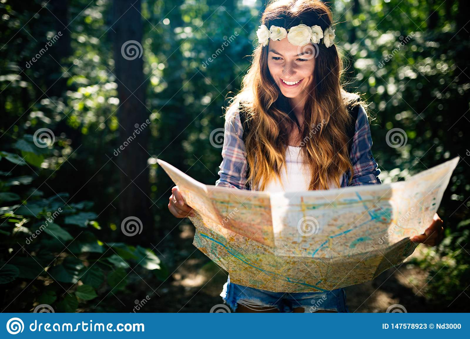 Hipster tourist woman with map hiking, lifestyle adventure concept
