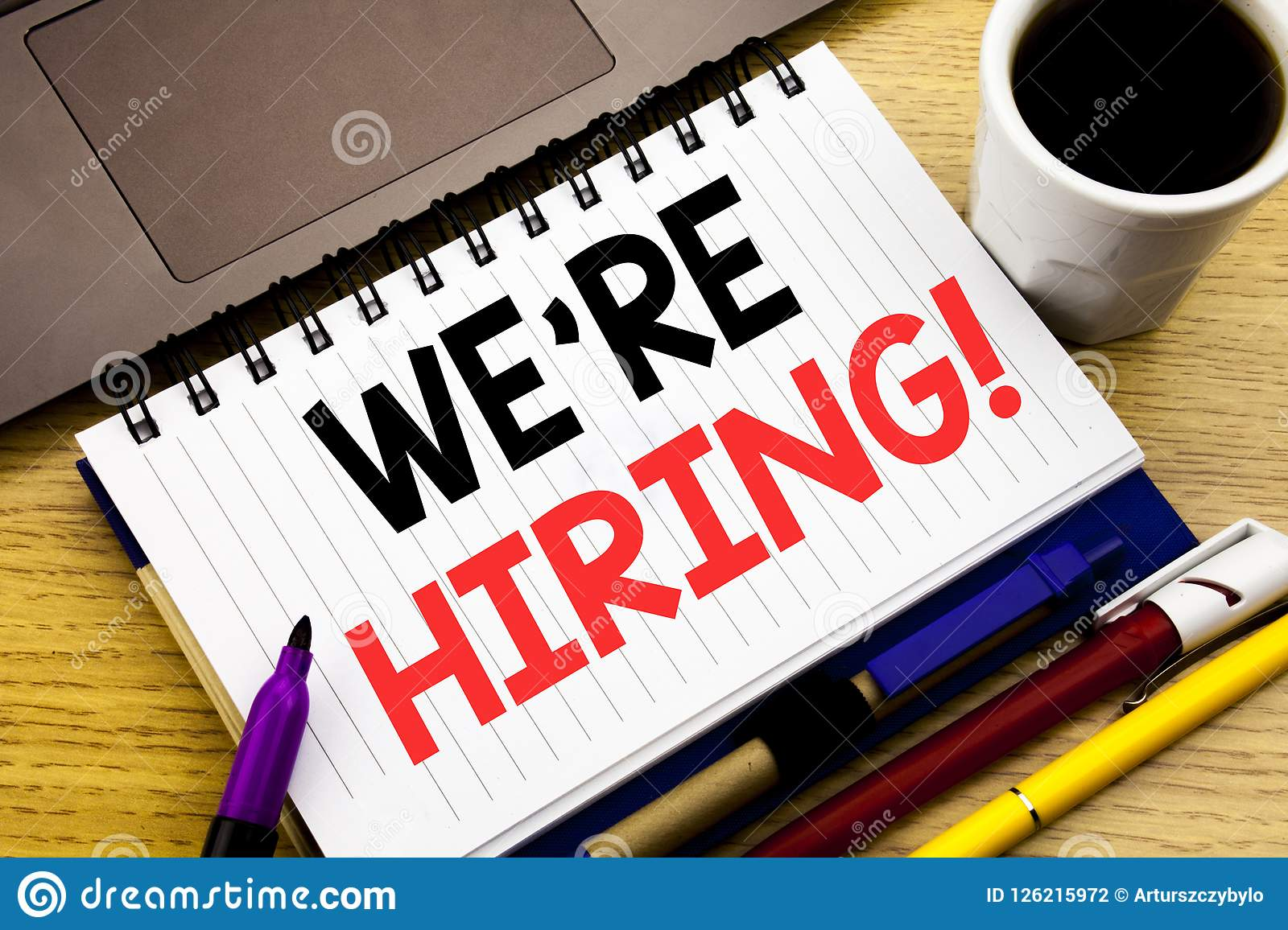 We Are Hiring Now. Business concept for Recruitment Human Resources written on notebook book on the wooden background in the Offi
