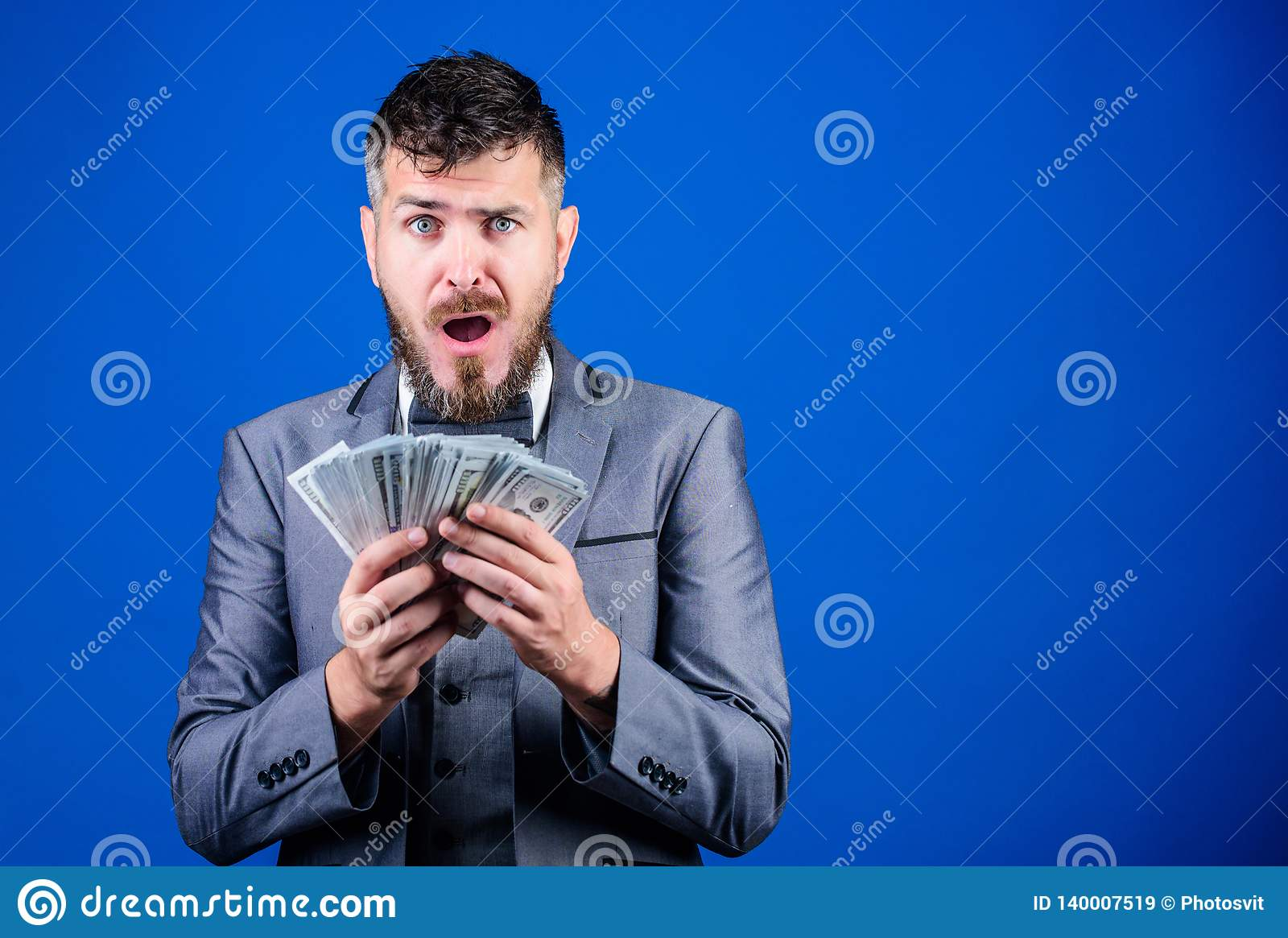 His first salary. Currency broker with bundle of money. Bearded man holding cash money. Rich businessman with us dollars