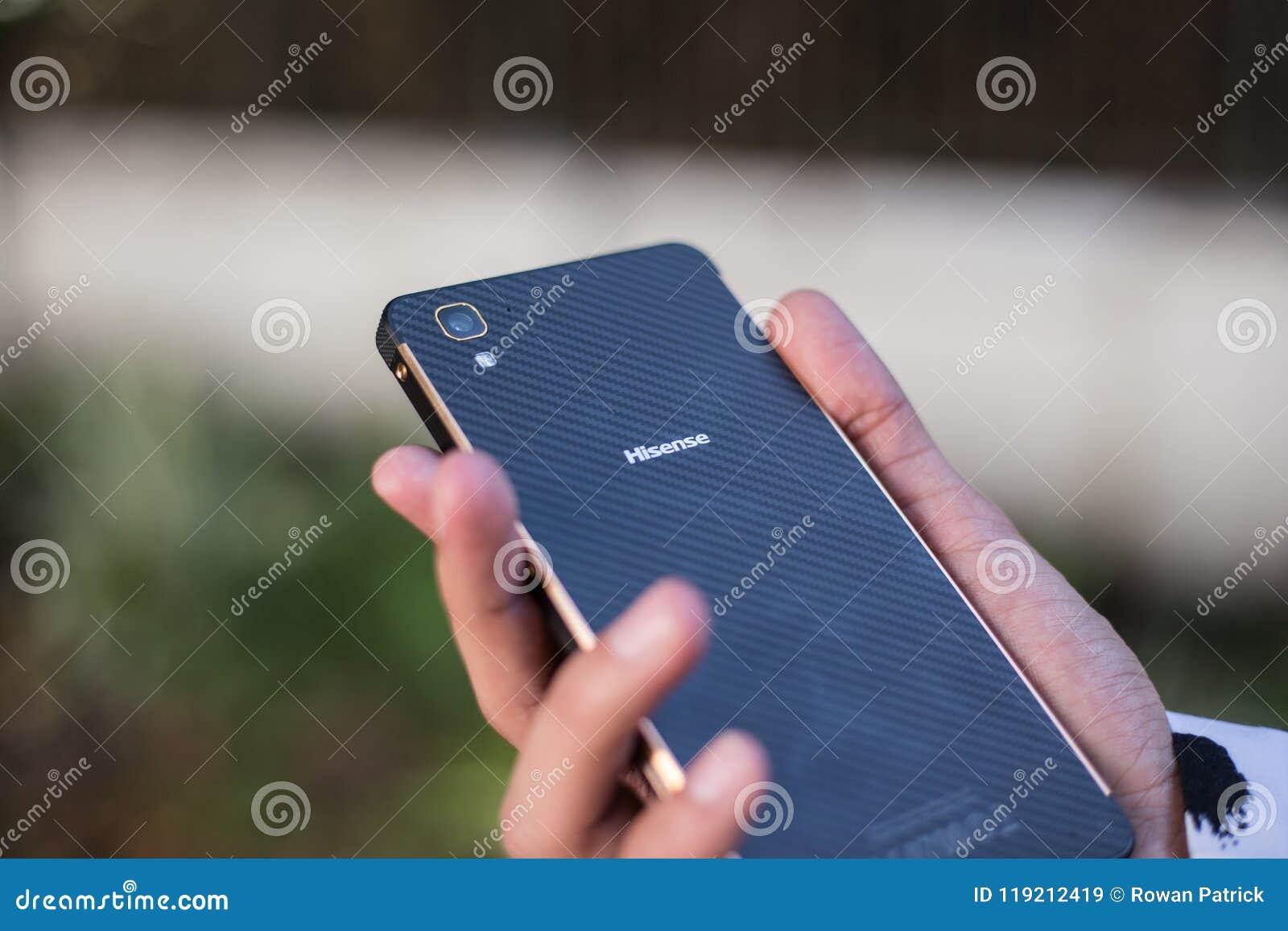 HiSense Phone in hand