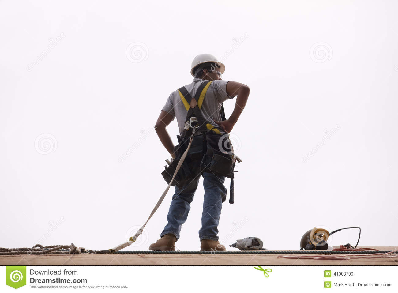 Hispanic Carpenter Standing On Roof With His Tools Stock Image ...