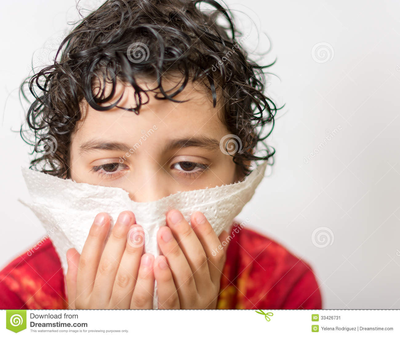 Hispanic Child Blowing His Nose Boy With A Runny Nose