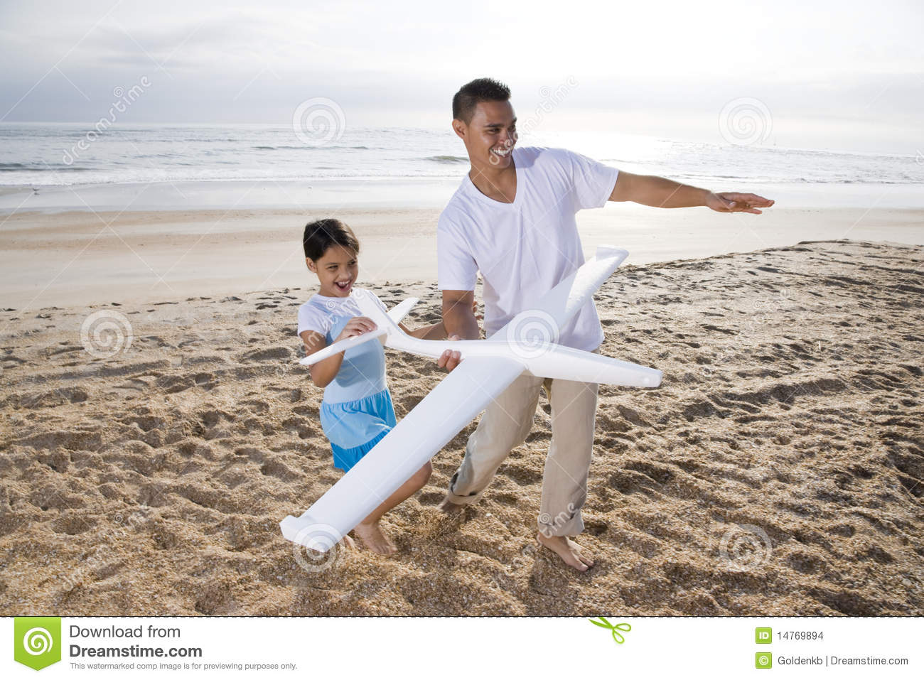 Download Hispanic Dad, Girl Playing With Toy Plane On Beach Stock Photo - Image of playing, cheerful: 14769894