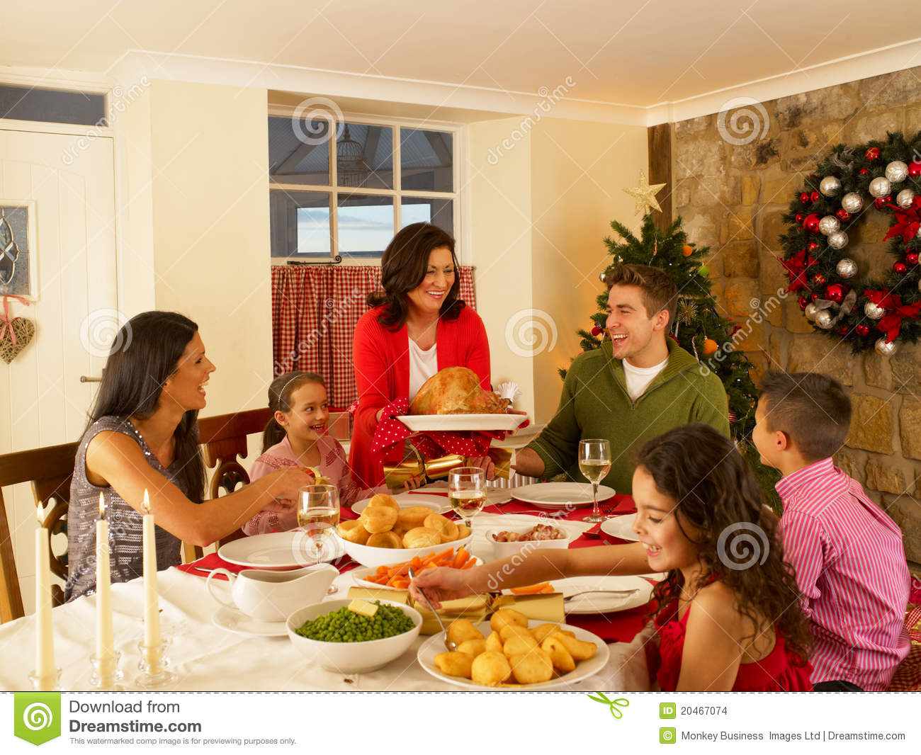 Hispanic Family At Home Serving Christmas Dinner Stock ...
