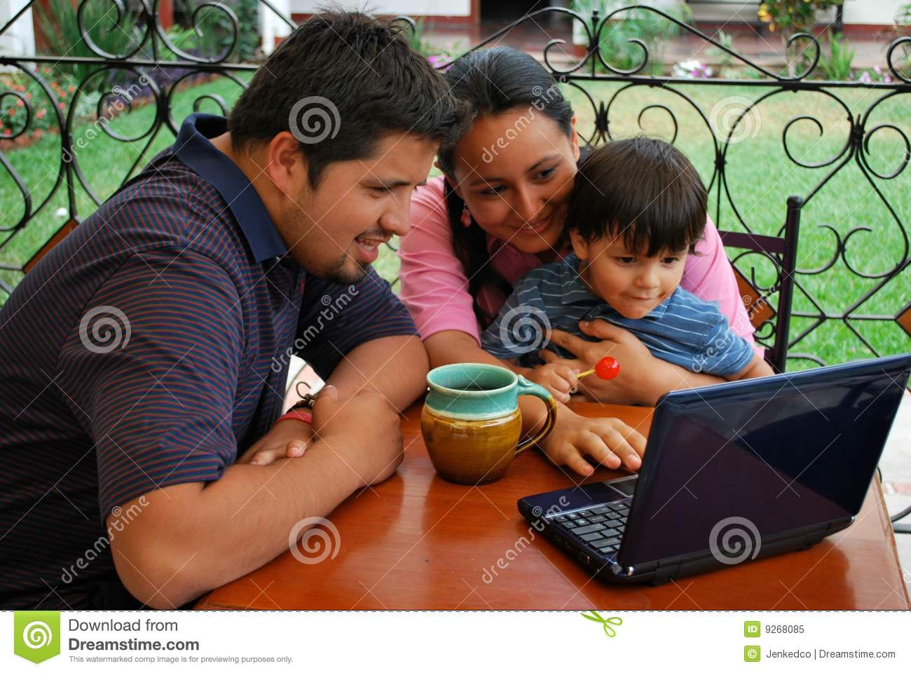 Hispanic family on laptop