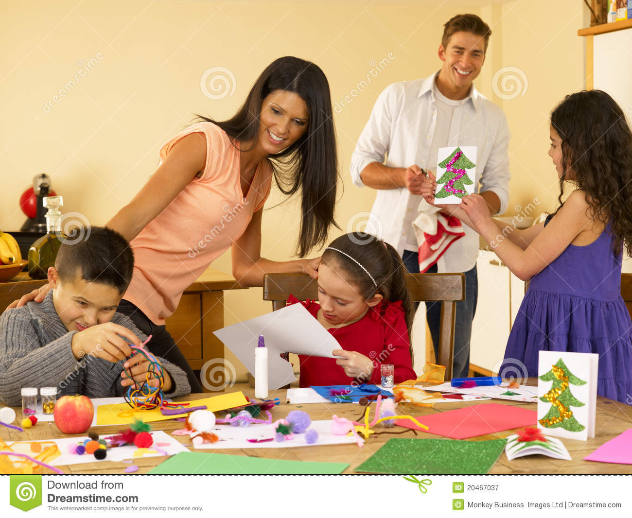 Hispanic Family Making Christmas Cards Royalty Free Stock