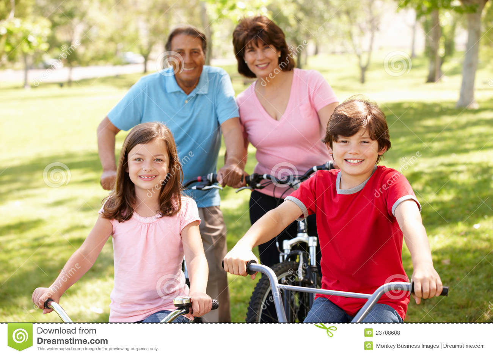 Hispanic family riding bikes in park