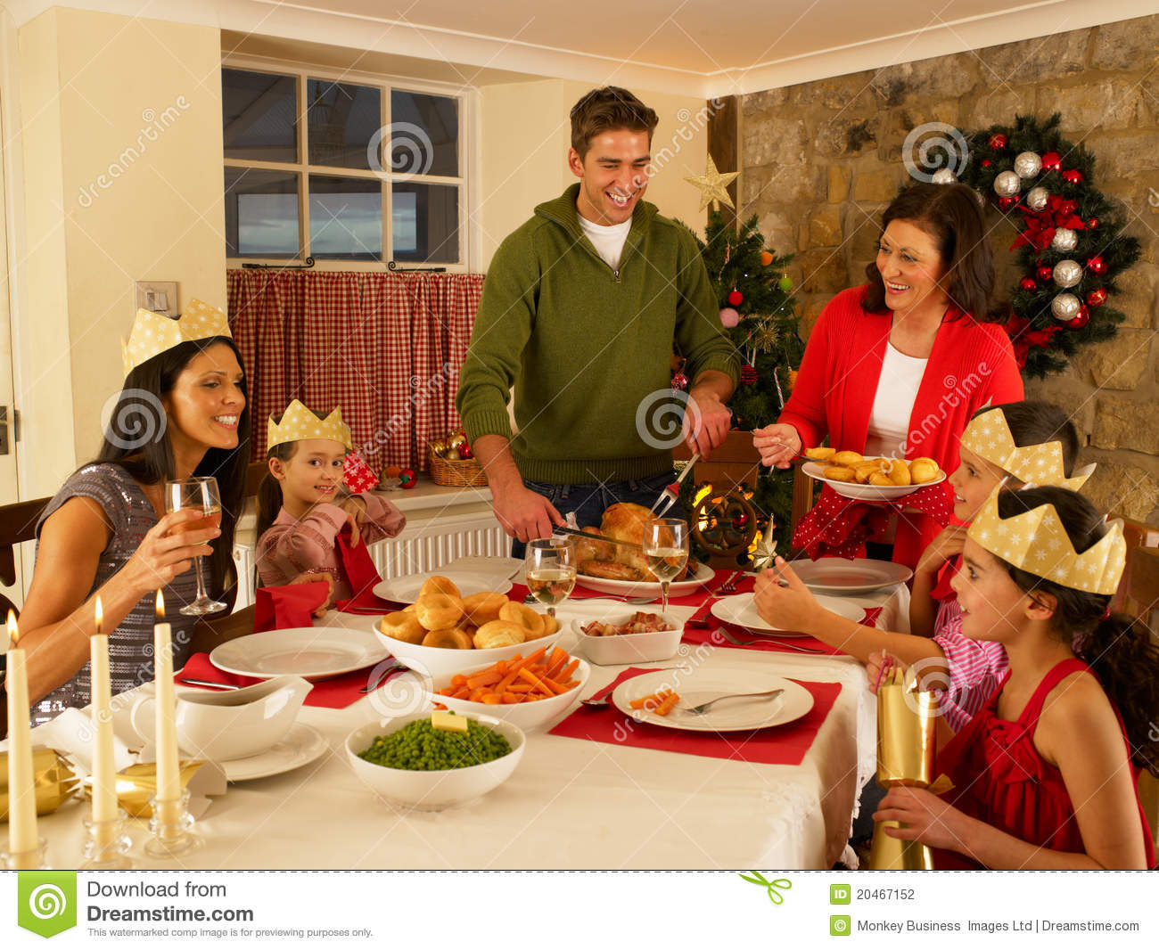 Hispanic family serving christmas dinner stock photo for Family diner
