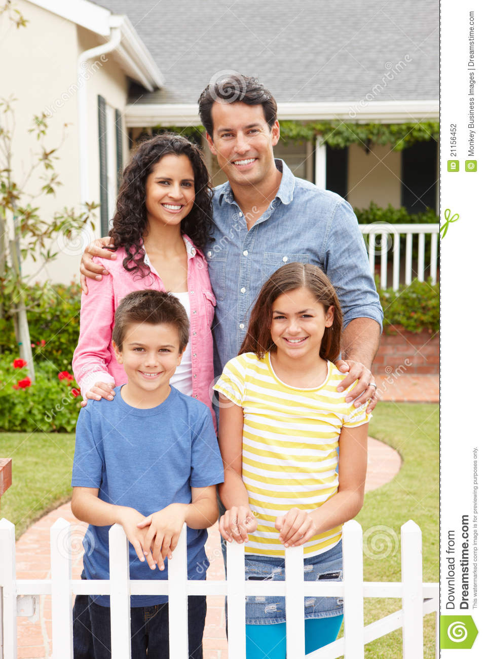 Hispanic family standing outside home stock photography for Family in house