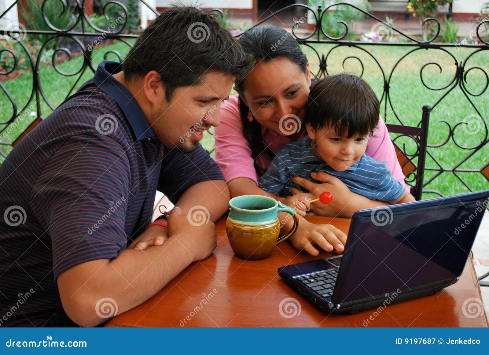 Hispanic family using a computer