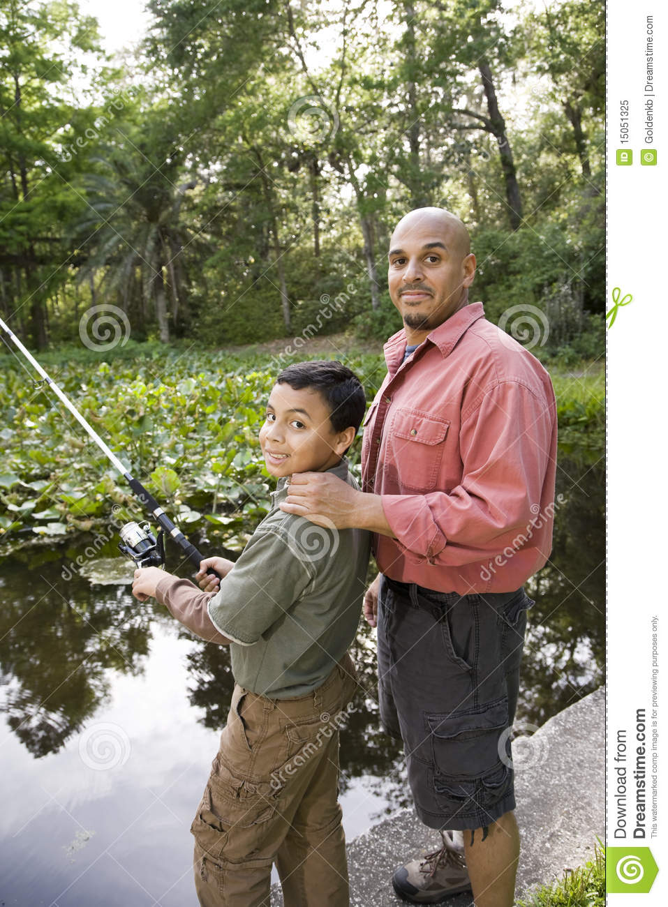 Hispanic father and son fishing in pond royalty free stock for Father son fishing