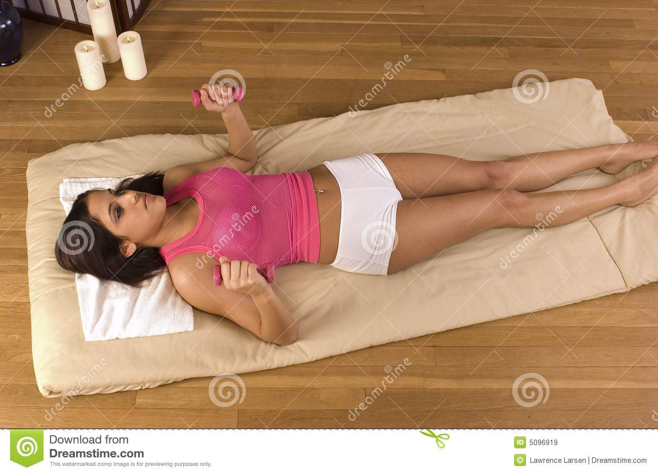 Hispanic girl on floor working out