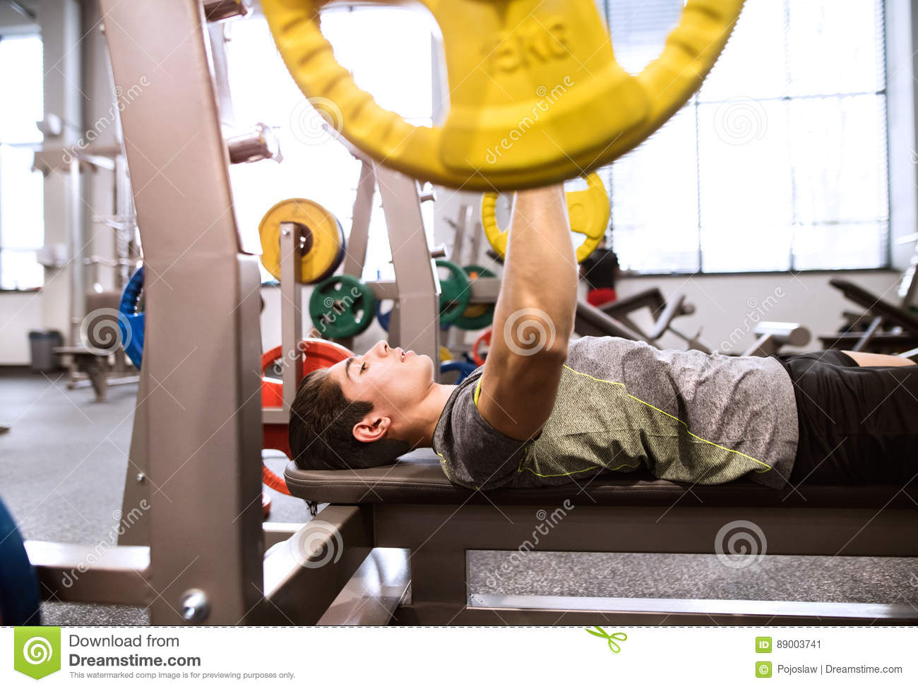 Cool Hispanic Man In Gym Working Out With Weights Bench Pressing Ibusinesslaw Wood Chair Design Ideas Ibusinesslaworg