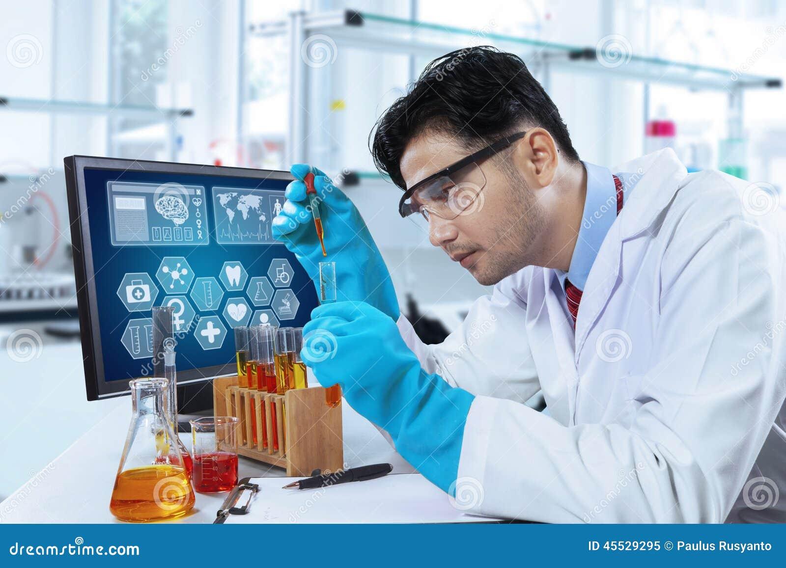 hispanic scientist working in laboratory stock photo image 45529295 discovery school clip art field trip discovery channel school clipart