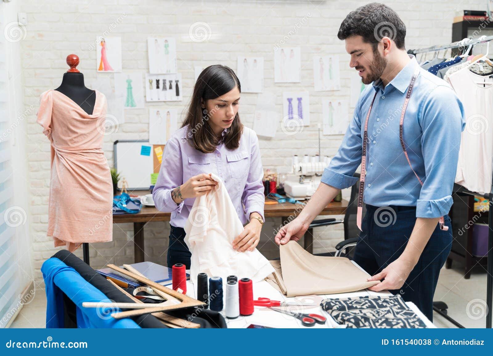 Latin Fashion Designers Finalizing Textile In Clothing Studio Stock Photo Image Of Communication Women 161540038