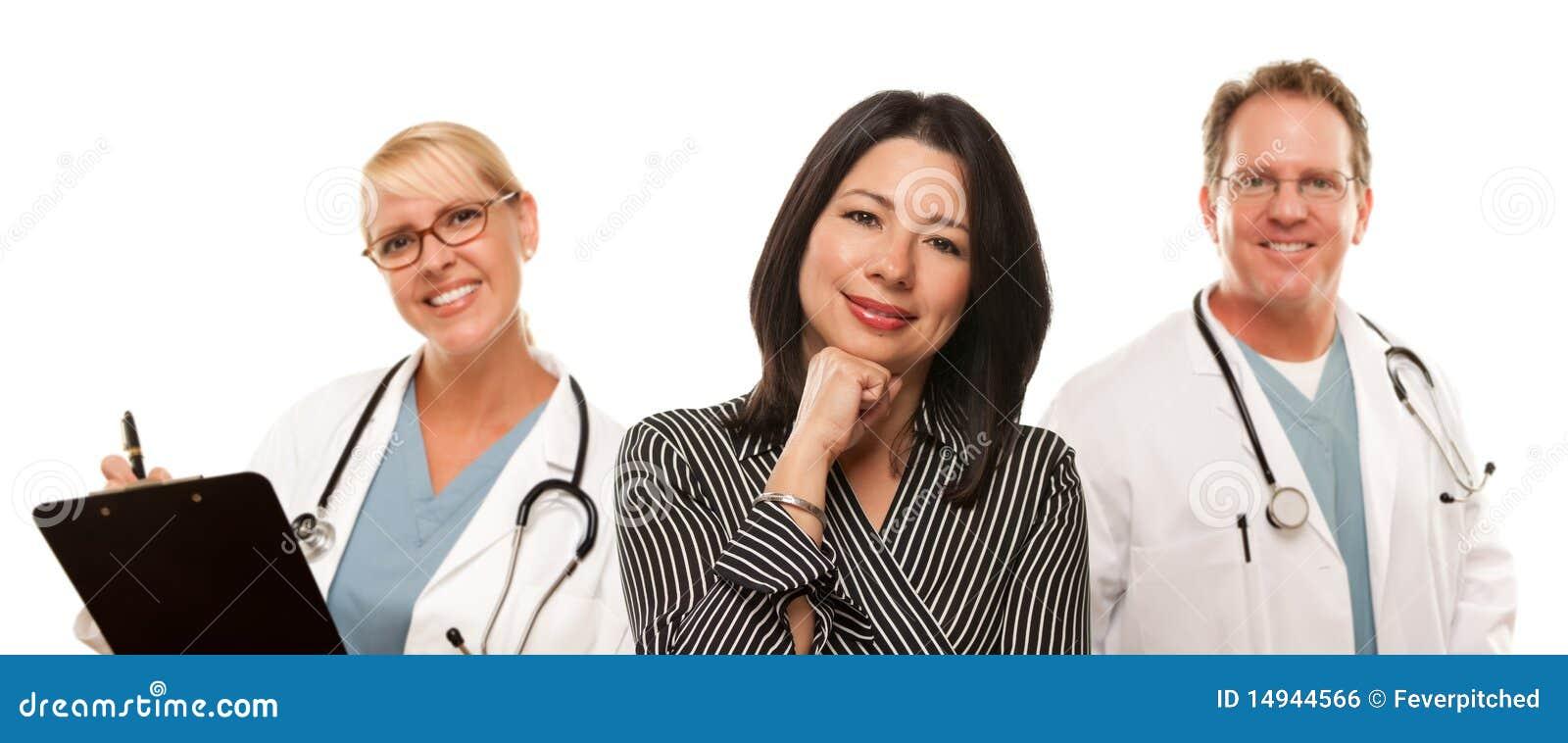 Hispanic Woman with Male Doctor and Nurse