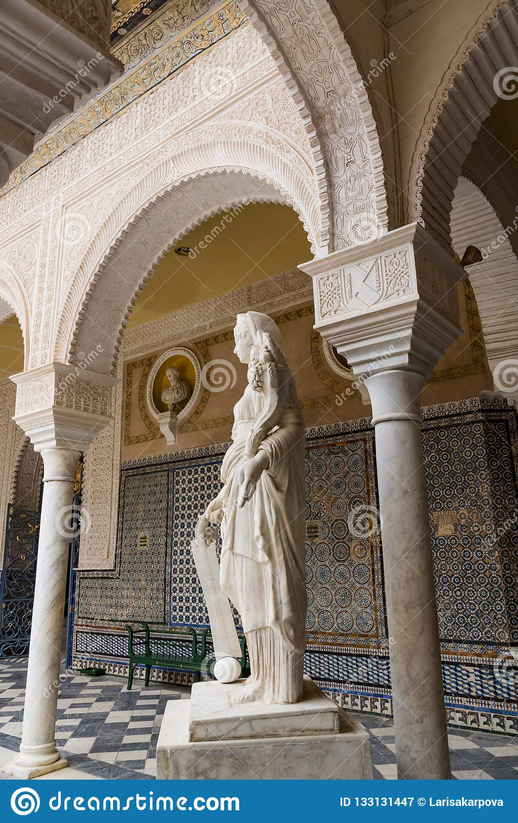 Historic buildings and monuments of Seville, Spain. hands. Statue. Marble