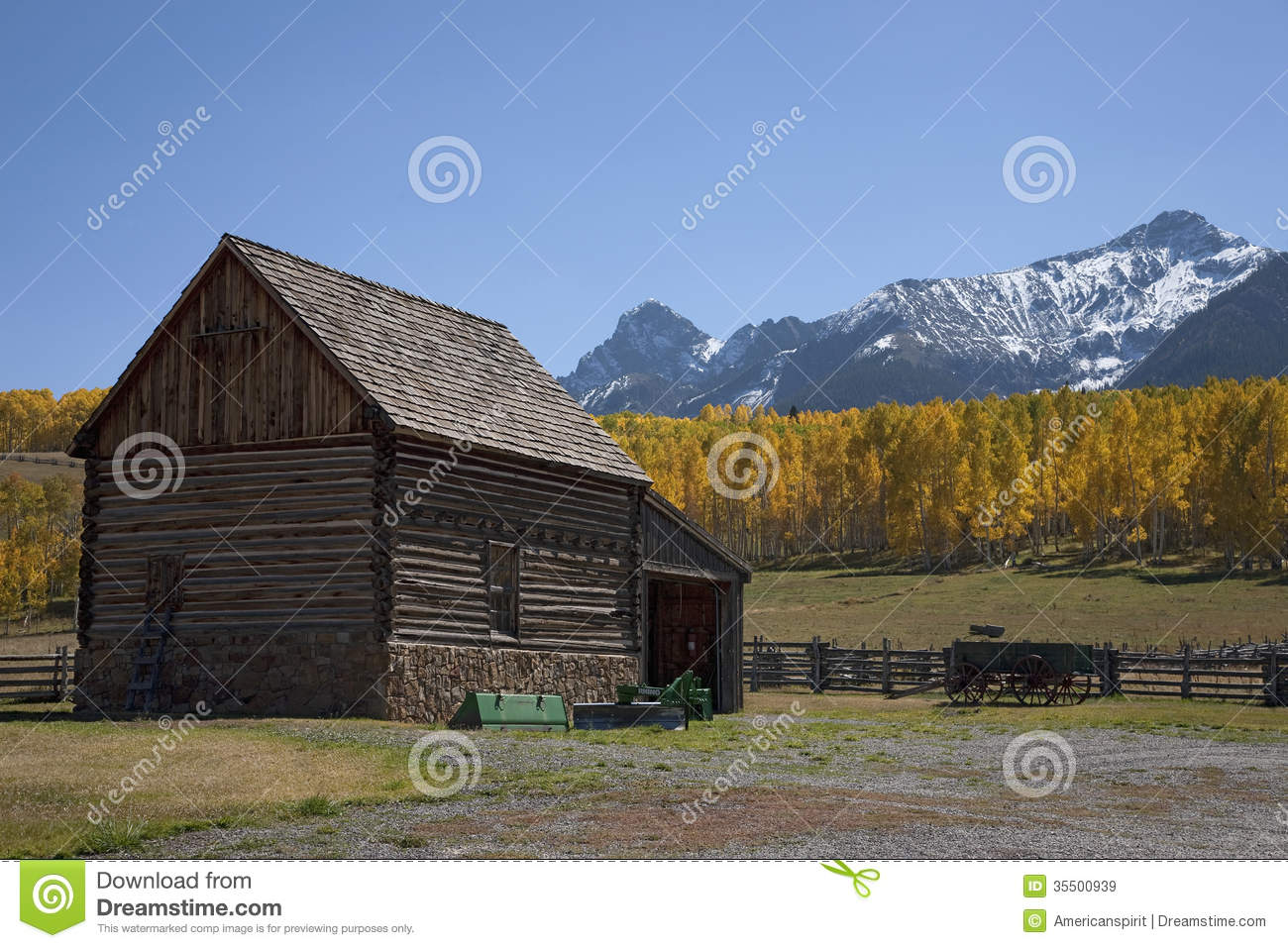 Autumn Log Cabin With Rail Fence Stock Photo
