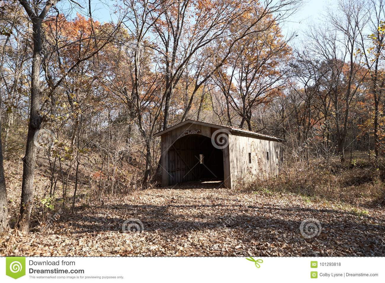 Historic Covered Wooden Bridge In Autumn Woodland Stock Photo