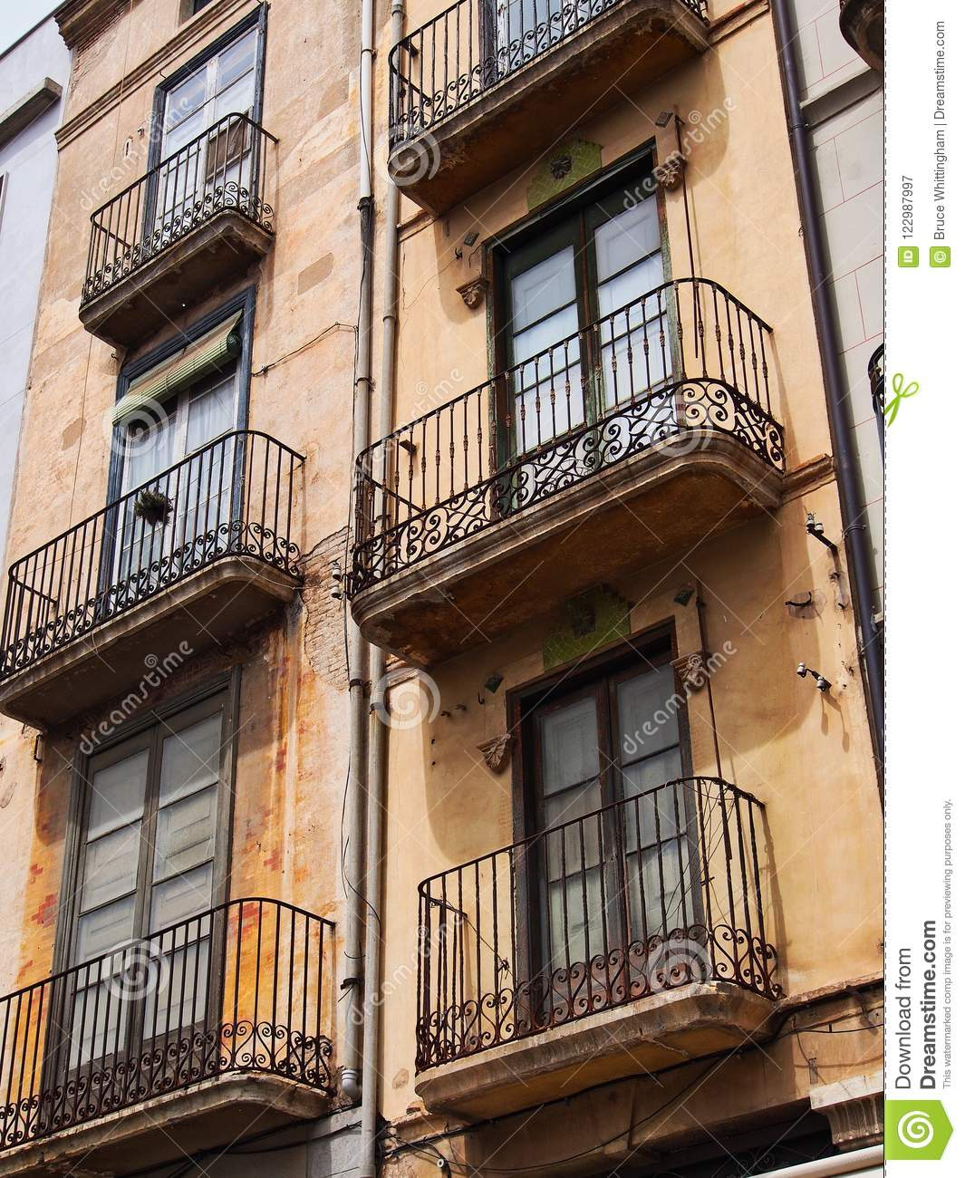 Old Brick Apartment Building: Historic Stucco Apartment Building, Figueres, Spain Stock